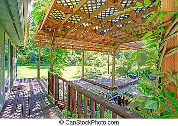 Backyard farm deck with attached open pergola