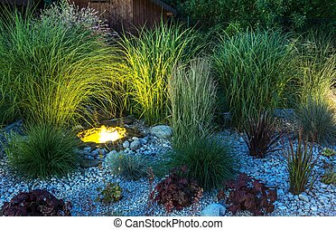 Backyard Garden illumination. Garden with Small Illuminated...