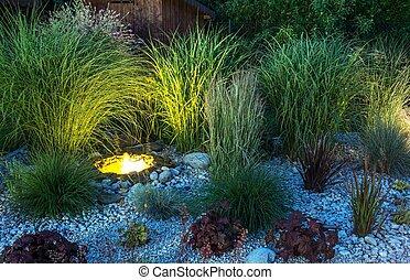 Backyard Garden illumination. Garden with Small Illuminated...