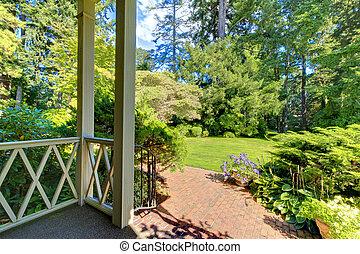 Backyard garden with brick walkway