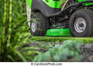 Backyard Grass Mowing Using Riding Garden Tractor
