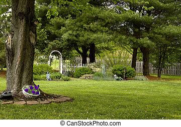 Backyard Landscape - Backyard landscape with trellis and...