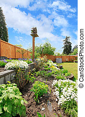 Backyard landscaping.  Flower beds
