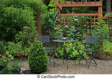 Backyard patio - Cozy little back yard terrace with table...