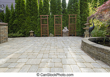 Garden Backyard Paver Patio with Pond Trellis Stone Pagoda Bronze Crane Sculptures Decoration