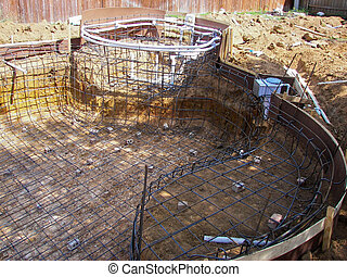 Outdoor swimming pool under contruction.
