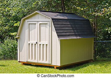 Backyard Shed - A wood utility shed in a back yard