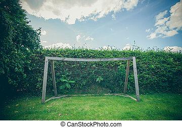 Backyard soccer goal on a green lawn