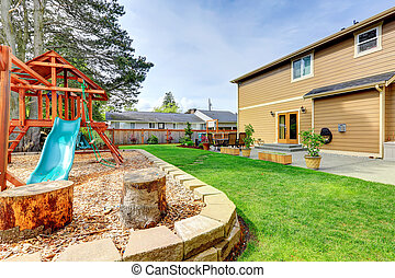 Backyard view - Backyard with patio area and playground for ...