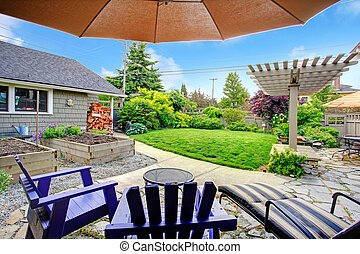 Backyard view from patio area - Fenced backyard with lawn,...
