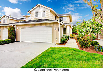 Backyard with garage and picturesque curb appeal - Siding...