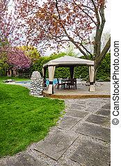 Backyard with gazebo and deck - Residential backyard with...