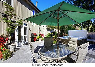 Backyard with patio and jacuzzi