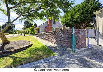 Backyard with stone wall