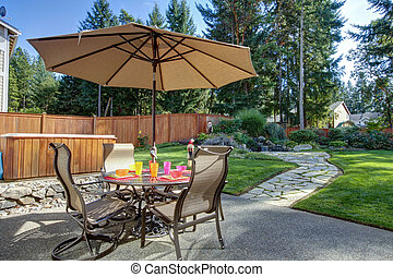 Backyard with table and unbrella