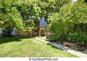 Backyard with tree house.