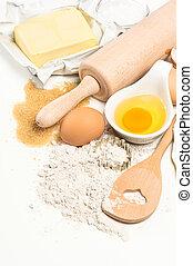 backzutaten, eier, mehl, zucker, butter., küchenutensilien