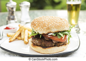 Bacon and Bleu Stuffed Cheeseburger topped with arugula ...