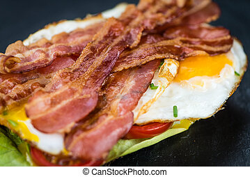 Bacon and Eggs (selective focus) - Portion of Bacon and Eggs...