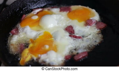 Fresh Morning fried eggs on pan with bacon and spices