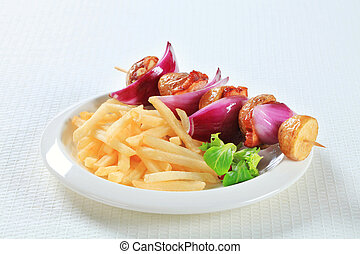 Bacon and potato skewer with fries