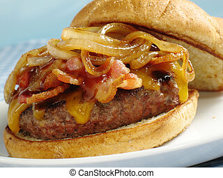 A juicy sirloin burger topped with cheddar cheese, bacon, barbecue sauce, and sauteed onions. Served on a toasted wheat bun.