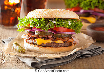 bacon cheese burger with pickles tomato onion