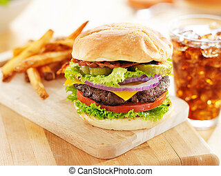 bacon cheeseburger with french fries and soft drink