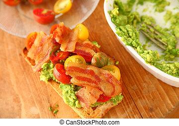 Bacon, cherry tomato and avocado sandwich