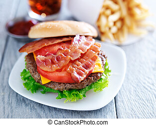 bacon chesseburger with fries and cola