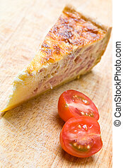Bacon quiche with a tomato
