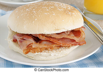 Bacon Sandwich or bacon butty selective focus on the bacon