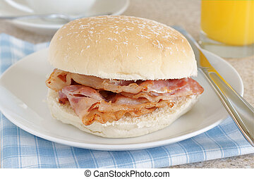 Bacon Sandwich or bacon roll selective focus on the bacon