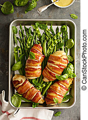 Bacon wrapped chicken breast with asparagus
