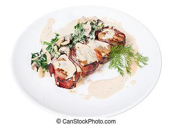 Bacon wrapped pork tenderloin.