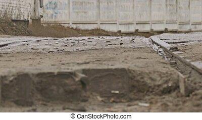 bad asphalt road cars drive on dirt autumn pits rain