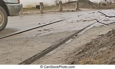bad asphalt road cars drive on dirt pits rain autumn
