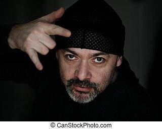 Bad boy - Mature man with a beard in black bandana