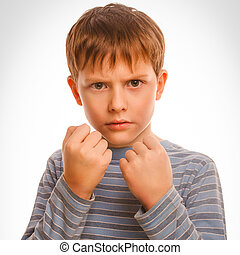 bad bully child boy blond angry aggressive fights in striped shirt isolated studio on white background