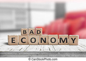 Bad economy sign on a wooden desk in an office