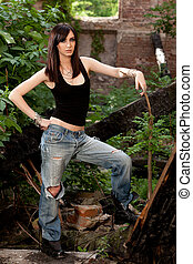 Stunning brunette with a bad attitude, wearing beautiful silver jewelry.