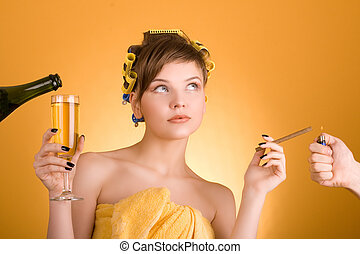 bad habit - girl with hair-rollers holding a cigarette and a...