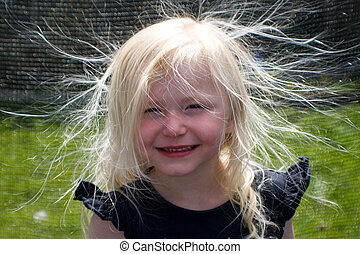 Bad hair day - Young girl with hair full of static ...