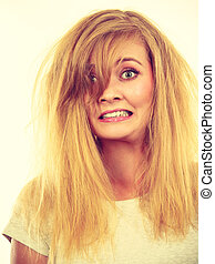 Crazy, mad blonde woman with messy hair - Bad hairstyle...