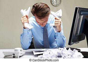 Bad ideas - Portrait of stressed businessman with crumbled ...