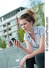 Bad message - unhappy woman with mobile phone