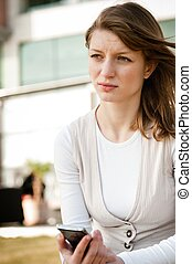 Bad message - unhappy woman with phone