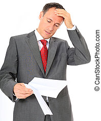 Attractive businessman gets bad news. All on white background.