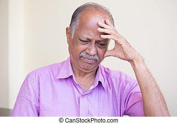 Bad news - Closeup portrait, morose elderly pensioner,...