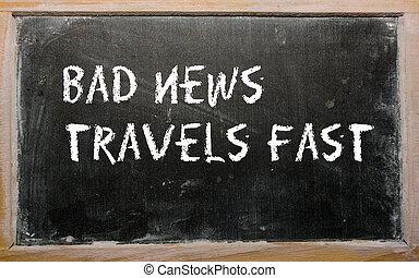 """""""Bad news travels fast"""" written on a blackboard"""